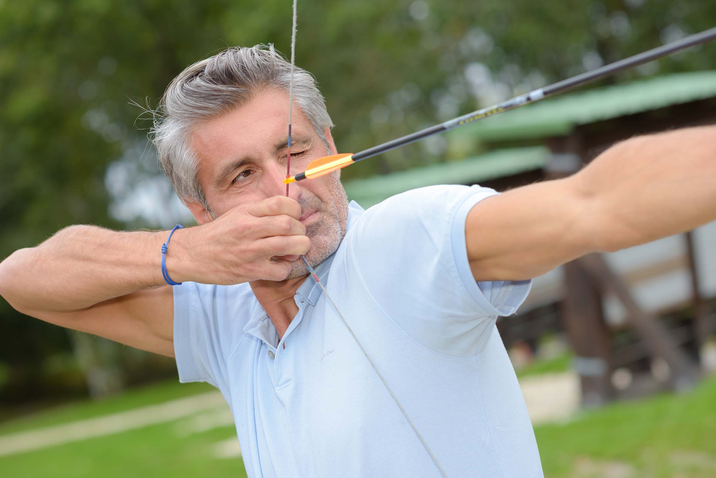 Man aiming bow and arrow